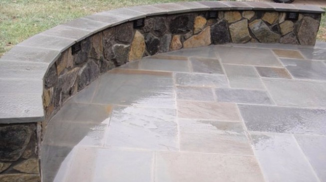 Stone patio with built in seating
